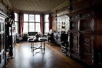 Heavy oak, Tudor furniture in the Tudor long gallery