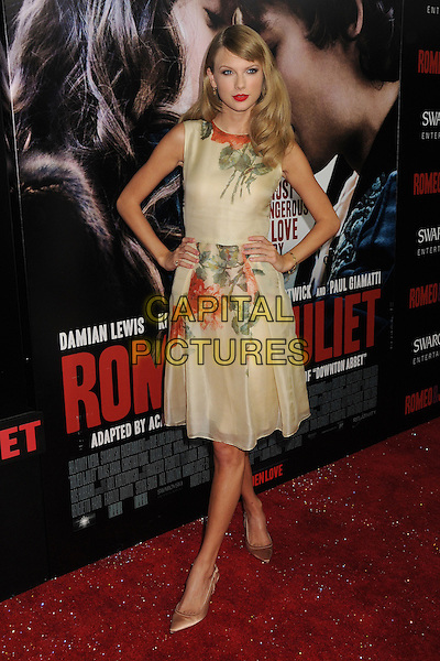 Taylor Swift<br /> &quot;Romeo &amp; Juliet&quot; Los Angeles Premiere held at Arclight Cinemas, Hollywood, California, USA.<br /> September 24th, 2013<br /> full length floral hands on hips yellow red green print dress sleeveless <br /> CAP/ADM/BP<br /> &copy;Byron Purvis/AdMedia/Capital Pictures