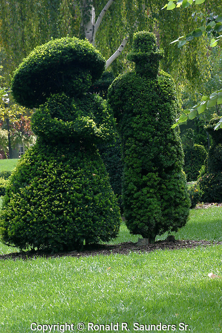 """A re-creation in sculpted shrubbery by French artist Georges Seurat's famous painting, """"A Sunday Afternoon on the Ile De La Grande Jatte.""""<br /> The topiary garden begun in 1989 by the Columbus Recreation and Parks Department,is a recreation in sculpted shrubbery of French artist Georges Seurat's famous painting, """"A Sunday Afternoon on the Ile de Grande Jatte"""" <br /> (1884-6).<br /> <br /> The topiary project was conceived, designed and executed by Columbus sculptor James T. Mason<br /> « less"""