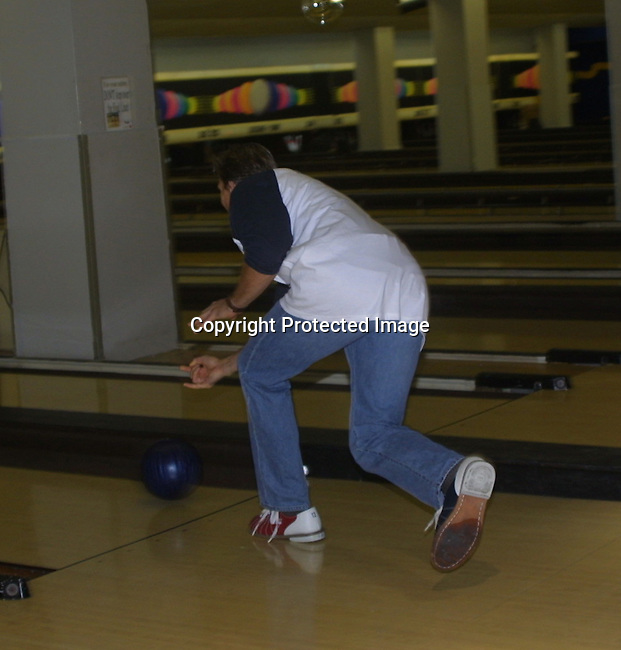 """Grant Alexander (Philip Spalding) right after he relearses the ball at the """"Bloss and Friends"""" bowling event hosted by Jerry verDorn (Ross) and Liz Kiefer at the Port Authority Bowling lanes to benefit the Cancer Foundation on October 9, 2004 (Photo by Sue Coflin)"""