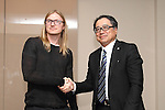 Kraken, a San Francisco-based bitcoin exchange, CEO Jesse Powel, left, attends a press conference of agreement of helping MTGOX in Tokyo on 25 Nov 2014. (Photo by Motoo Naka/AFLO)