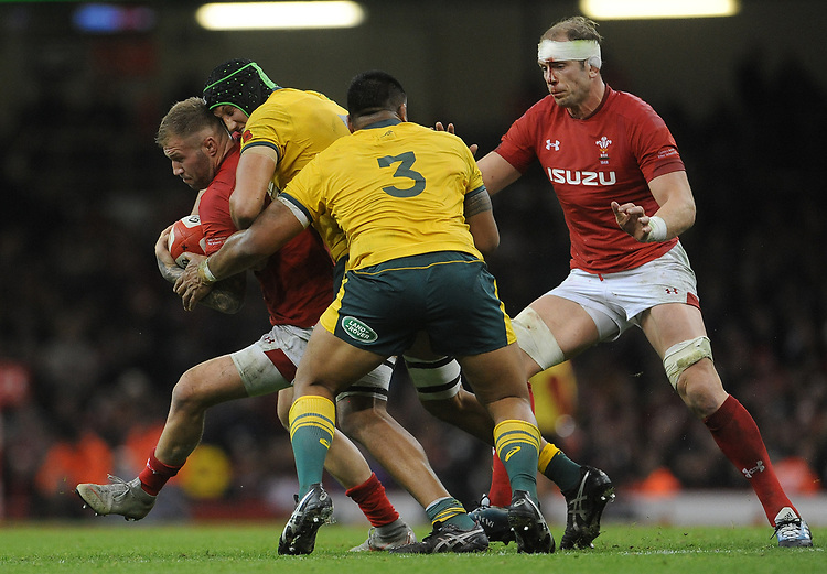 Wales' Ross Moriarty is tackled by Australia's Adam Coleman<br /> <br /> Photographer Ian Cook/CameraSport<br /> <br /> Under Armour Series Autumn Internationals - Wales v Australia - Saturday 10th November 2018 - Principality Stadium - Cardiff<br /> <br /> World Copyright © 2018 CameraSport. All rights reserved. 43 Linden Ave. Countesthorpe. Leicester. England. LE8 5PG - Tel: +44 (0) 116 277 4147 - admin@camerasport.com - www.camerasport.com