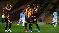 Scorer hope Akpan is congratulated by Tyler French and Zeli Ismail after he scores to make it 1-0 during the The Leasing.com Trophy match between Bradford City and Manchester City U21 at the Utilita Energy Stadium, Bradford, England on 24 September 2019. Photo by Thomas Gadd.