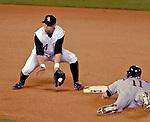 8 September 2006: Troy Tulowitzki (14), shortstop for the Colorado Rockies, attempts catching a steal by a diving Ryan Zimmerman (11) of the Washington Nationals. The Rockies defeated the Nationals 11-8 at Coors Field in Denver, Colorado...Mandatory Photo Credit: Ed Wolfstein.