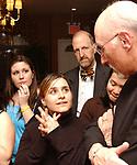 Alejandra Villa speaking to Jim Dooley at retirement dinner for Dooley held at the Manducatis Restaurant in long Island City on Wednesday February 9, 2005. (Photo copyright Jim Peppler 2005).