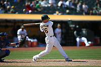 OAKLAND, CA - AUGUST 16:  Matt Chapman #26 of the Oakland Athletics hits a home run against the Kansas City Royals during the game at the Oakland Coliseum on Wednesday, August 16, 2017 in Oakland, California. (Photo by Brad Mangin)