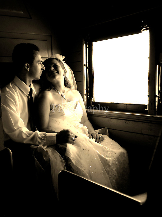 Wedding photo was taken on a old train carriage still on tracks made for a lovely photo session for this beautiful couple.