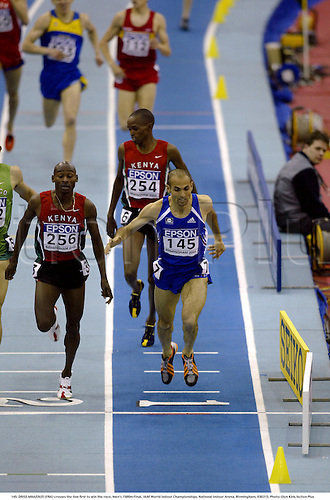145. DRISS MAAZOUZI (FRA) crosses the line first to win the race, Men's 1500m Final, IAAF World Indoor Championships, National Indoor Arena, Birmingham, 030315. Photo: Glyn Kirk/Action Plus...2003.athletics track and field athlete .run runs running runner runners distance.win winner winning winners wins finish finishing