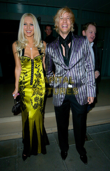 EMMA NOBLE & RICK PARFITT.The Laurent-Perrier Pink Party, Suka, Sanderson Hotel, London, England. .April 25th, 2007 .full length green satin dress black floral print holding hands striped striped purple jacket.CAP/CAN.©Can Nguyen/Capital Pictures