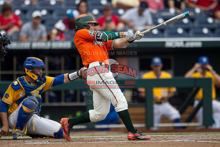 Miami Hurricanes second baseman Johnny Ruiz (4) swings the bat against the UC Santa Barbara Gauchos in Game 5 of the NCAA College World Series on June 20, 2016 at TD Ameritrade Park in Omaha, Nebraska. UC Santa Barbara defeated Miami  5-3. (Andrew Woolley/Four Seam Images)