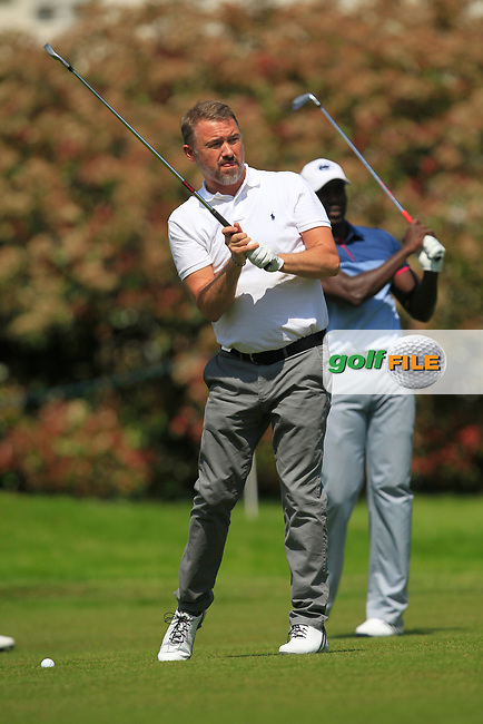 Stephen Hendry (AM) and Dwight Yorke (AM) on the 18th fairway during the Pro-Am of The BMW PGA Championship  at Wentworth Golf Club on Wednesday 24rd May 2017.<br /> Photo: Golffile / Thos Caffrey.<br /> <br /> All photo usage must carry mandatory copyright credit     (&copy; Golffile | Thos Caffrey)