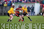 Jimmy Holly(4) of Tarbert feels the pressure from Listowel Emmets David Sheehy(11) and Brian Scanlon(15) in the North Kerry Senior Football Final held last Sunday in Bob Stack Park, Ballybunion...