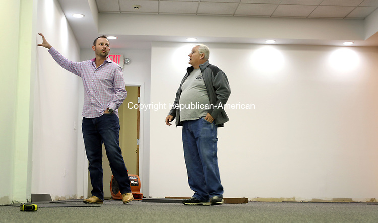 WATERTOWN CT. 09 May 2017-050917SV03-From left, Brandon Dufour, general manager, talks with John Eastwood, owner of Eastwood&rsquo;s Fine Finishes, about his company&rsquo;s new classroom at 680 Main Street in Watertown Tuesday. The Next Street Driving School is expanding to that location.<br /> Steven Valenti Republican-American