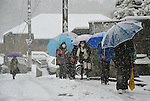February 29, 2012, Tokorozawa, Japan - A group of school children treads their way in the snow in Tokorozawa, Tokyos western suburb, on Wednesday, February 29, 2012. A freak early spring storm triggered by low pressure in the Pacific Ocean south of Japan brought fresh snow over wide swaths in the Kanto Area from the wee hour of Wednesday, disrupting land-sea-air transportation services. (Photo by Natsuki Sakai/AFLO) AYF -mis-