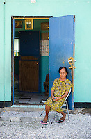A Marshalles woman sits by the door of her house in Jabor, Jaluit.