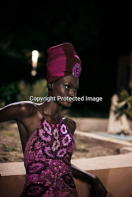 DAKAR, SENEGAL - JUNE 21: A models for the Nigerian designer label Ejiro Amos Tafiri waits backstage before a show at Dakar Fashion Week on June 21, 2014, at Hotel des Almadies in Dakar, Senegal. Seventeen Senegalese, African and foreign-based designers showed their collections during the 12th edition of Dakar Fashion week. (Photo by Per-Anders Pettersson)