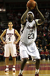 DeAngelo Casto (#23), Washington State University forward, concentrates on the line as he prepares to shoot a free throw as teammate Nikola Koprivica (#4) looks on during the Cougars game with Montana State at Key Arena in Seattle, Washington, on December 13, 2008.  WSU beat Montana State 70-51.