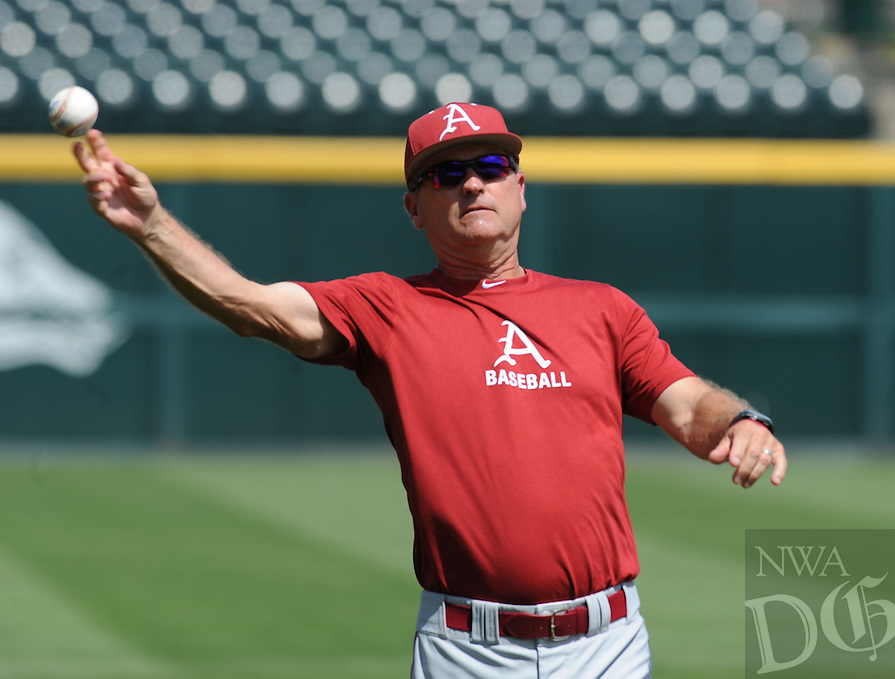 NWA Democrat-Gazette/ANDY SHUPE<br /> Arkansas coach Dave Van Horn throws a ball Thursday, June 4, 2015, during practice at Baum Stadium in Fayetteville ahead of the start of the Fayetteville Super Regional which begins today.