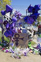 "Purple balloons, flowers and ""Love Symbol"" honoring Prince. Paisley Park Studios Chanhassen Minnesota MN USA"