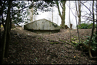 BNPS.co.uk (01202 558833)<br /> Pic: AlexanderBagnall/BNPS<br /> <br /> 2009 the Hope Mausoleum had almost entered the underworld...<br /> <br /> Back from the dead - Before and after photos show how a 19th century mausoleum was brought back from the underworld thanks to a life saving restoration. <br /> <br /> Hope Mausoleum in Dorking, Surrey, was erected as a stately tomb in 1818 but 60 years ago it fell into disrepair and became buried by soil. <br /> <br /> However, following the recent completion of an extensive restoration the Grade II listed building has been returned to its former glory. <br /> <br /> Proprietors Mole Valley District Council spearheaded the project after employee Alex Bagnall discovered the tip of the building while investigating the surrounding area. <br /> <br /> After securing a &pound;1m grant from the heritage lottery fund the project began, with architects, stonemasons, ground workers and volunteers all descending on the historic plot.