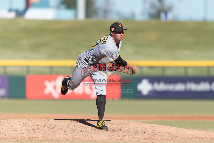 Surprise Saguaros relief pitcher Geoff Hartlieb (70), of the Pittsburgh Pirates organization, follows through on his delivery during an Arizona Fall League game against the Mesa Solar Sox at Sloan Park on November 15, 2018 in Mesa, Arizona. Mesa defeated Surprise 11-10. (Zachary Lucy/Four Seam Images)
