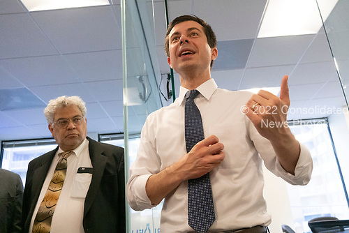 Bluelight Founder Steve Rabinowitz listens on as Mayor Pete Buttigieg meets with leaders of the Jewish community at a communal parlor meeting at the offices of Bluelight Strategies in Washington D.C., U.S. on May 23, 2019.<br /> <br /> Credit: Stefani Reynolds / CNP