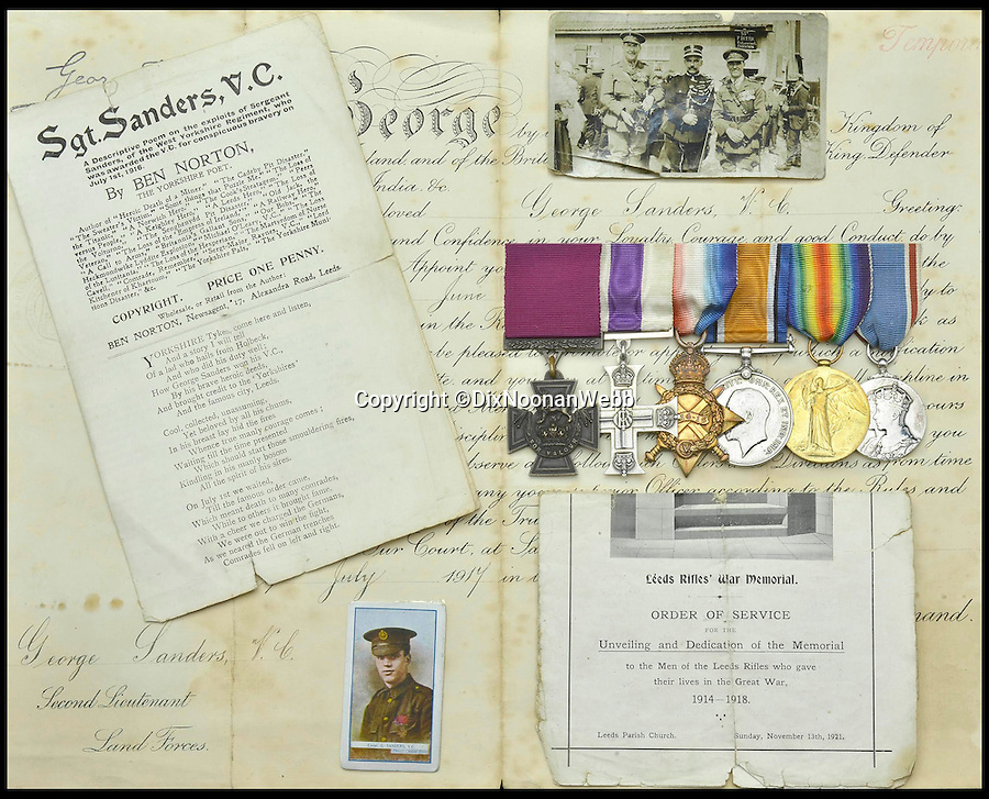 BNPS.co.uk (01202 558833)<br /> Pic: DixNoonanWebb/BNPS<br /> <br /> The decorations, medals, documents and photos being sold by Dix Noonan Webb.<br /> <br /> A Victoria Cross awarded to a hero British soldier on the first day of the Somme is being sold by his family for £220,000 over 100 years later.<br /> <br /> Corporal George Sanders led a band of 30 men in repelling repeated German attacks over two days after a communications break down left them cut off in an enemy trench.<br /> <br /> For nearly two days without any food or water, he drove off a raid by the enemy which required hand-to-hand combat using bayonets and then stood firm against two strong bombing attacks.<br /> <br /> His Victoria Cross and Military Cross have been passed down through the family and are now to be sold for the very first time at London auctioneers Dix Noonan Webb.