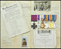 BNPS.co.uk (01202 558833)<br /> Pic: DixNoonanWebb/BNPS<br /> <br /> The decorations, medals, documents and photos being sold by Dix Noonan Webb.<br /> <br /> A Victoria Cross awarded to a hero British soldier on the first day of the Somme is being sold by his family for &pound;220,000 over 100 years later.<br /> <br /> Corporal George Sanders led a band of 30 men in repelling repeated German attacks over two days after a communications break down left them cut off in an enemy trench.<br /> <br /> For nearly two days without any food or water, he drove off a raid by the enemy which required hand-to-hand combat using bayonets and then stood firm against two strong bombing attacks.<br /> <br /> His Victoria Cross and Military Cross have been passed down through the family and are now to be sold for the very first time at London auctioneers Dix Noonan Webb.