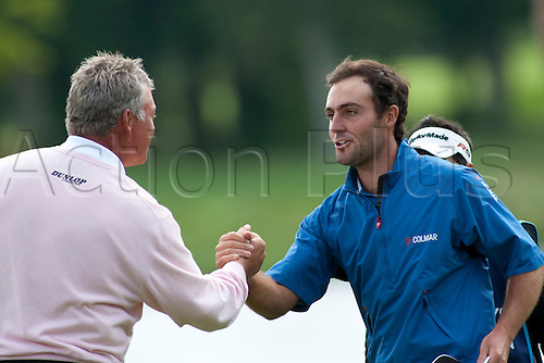 LOCH LOMOND SCOTLAND. 11-07-2010. Edoardo Molinari (ITA)  (r) shakes hand with Darren Clarke (GBR) after winning the PGA European Tour, Barclays Scottish Open part of The Race to Dubai Tournament.