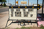 "Marquee sign on a city street in the Texas Panhandle: ""You have the right to remain silent so please shut up"""