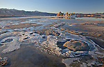 In winter, tufa towers made from calcium-carbonate rise out of the icy shoreline of Mono Lake at the Mono Lake Tufa State Natural Reserve in California, USA