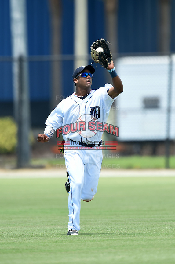 GCL Tigers outfielder Derek Hill (30) catches a fly ball during a game against the GCL Blue Jays on June 30, 2014 at Tigertown in Lakeland, Florida.  GCL Blue Jays defeated the GCL Tigers 3-1.  (Mike Janes/Four Seam Images)
