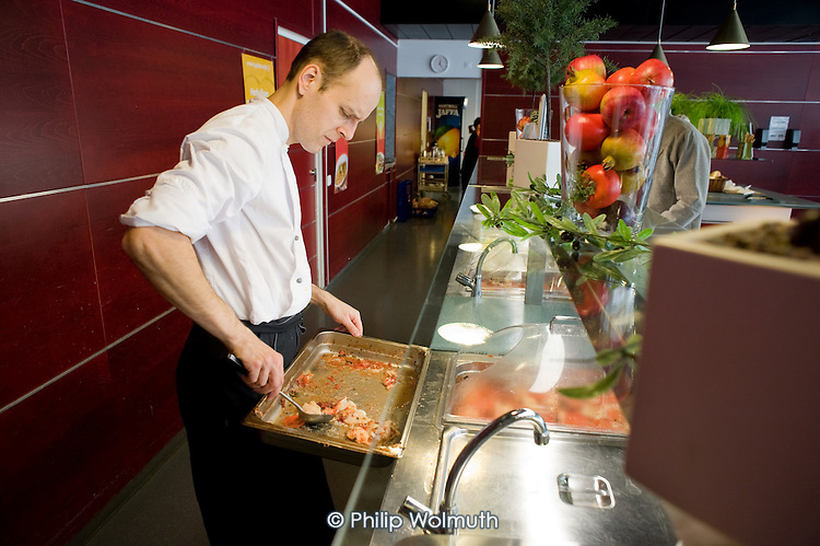 Catering worker in a canteen in a municipal building in Helsinki run by Palmia, a municipal enterprise, which also provides school meals, meals on wheels, cleaning, and security services across the Finnish capital.
