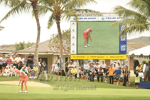 Feb 25, 2006; Kapolei, HI, USA;  Natalie Gulbis putts on the 18th green during the final round at the inaugural LPGA Fields Open at Ko Olina Resort. ..Photo Credit: Darrell Miho .Copyright © 2006 Darrell Miho
