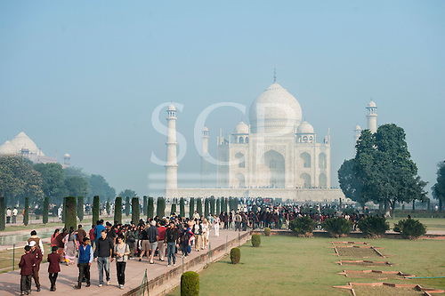 Agra, Utar Pradesh, India.Taj Mahal in the morning mist and tourists.