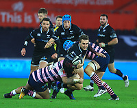 Ospreys' Ashley Beck is tackled by Cardiff Blues' Willis Halaholo and Olly Robinson.<br /> <br /> Photographer Dan Minto/CameraSport<br /> <br /> Guinness Pro14 Round 13 - Ospreys v Cardiff Blues - Saturday 6th January 2018 - Liberty Stadium - Swansea<br /> <br /> World Copyright &copy; 2018 CameraSport. All rights reserved. 43 Linden Ave. Countesthorpe. Leicester. England. LE8 5PG - Tel: +44 (0) 116 277 4147 - admin@camerasport.com - www.camerasport.com