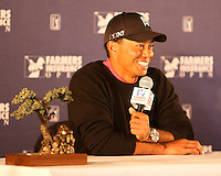 28 JAN 13  Tournament Champion Tiger Woods meets the press at the conclusion of Sunday's Final Round of The Farmers Insurance Open at Torrey Pines Golf Course in La Jolla, California. (photo:  kenneth e.dennis / kendennisphoto.com)