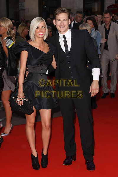 SAMMI MILLAR & LEE RYAN .World Premiere of 'The Heavy' at the Odeon West End, Leicester Square, London, England, UK. .April 15th 2010 .full length black tie suit white shirt waistcoat miller couple dress corset ankle boots booties clutch bag.CAP/AH.©Adam Houghton/Capital Pictures.