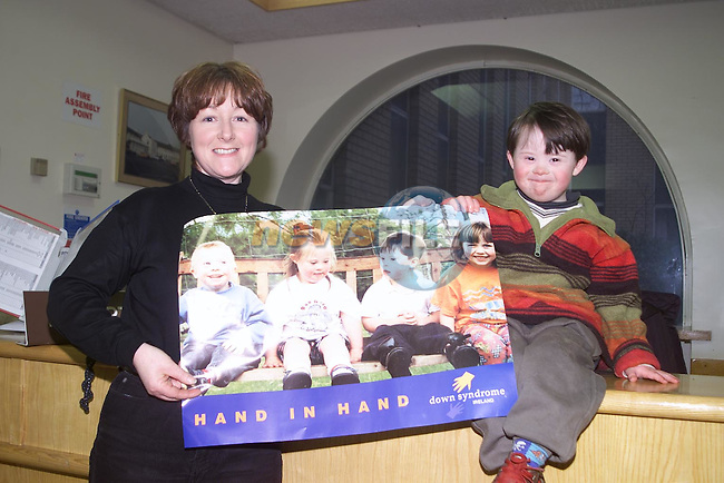 Conor and Audrey O'Dowd at the Louth Meath Down Syndrom stand at the Health Fayer in the Lourdes Hospital..Pic Fran Caffrey Newsfile..Camera:   DCS620C.Serial #: K620C-01974.Width:    1728.Height:   1152.Date:  12/2/00.Time:   17:13:45.DCS6XX Image.FW Ver:   3.0.9.TIFF Image.Look:   Product.Antialiasing Filter:  Removed.Tagged.Counter:    [1629].Shutter:  1/20.Aperture:  f4.5.ISO Speed:  200.Max Aperture:  f3.5.Min Aperture:  f22.Focal Length:  24.Exposure Mode:  Manual (M).Meter Mode:  Color Matrix.Drive Mode:  Continuous High (CH).Focus Mode:  Single (AF-S).Focus Point:  Center.Flash Mode:  Normal Sync.Compensation:  +0.0.Flash Compensation:  +0.0.Self Timer Time:  5s.White balance: Custom.Time: 17:13:45.894.
