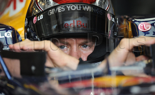 German race driver Sebastian Vettel of Team Red Bull sits in his car during the third training for the Hungarian Grand Prix in Budapest,Hungar, 31 July 2010. The Hungarian Grand Prix will take place on 1 August as the twelfth race of the 2010 Formula One season.