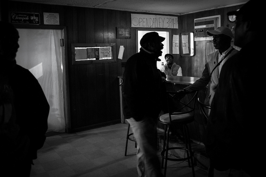 "Men hang out in the D&F bar, one of the juke joints on Mosquito Beach in the Sol Legare community on James Island. The ""beach"" is a quarter-mile strip of marshland and mud, but back when segregation was still in effect, it was one of the few waterfront areas that welcomed African Americans. There was not much swimming to be had but they danced, drank and ate in the restaurants and juke joints."