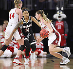 SIOUX FALLS, SD: MARCH 5: Jaycee Bradley #12 of South Dakota drives on Omaha defender Marissa Preston #14 during the Summit League Basketball Championship on March 5, 2017 at the Denny Sanford Premier Center in Sioux Falls, SD. (Photo by Dick Carlson/Inertia)
