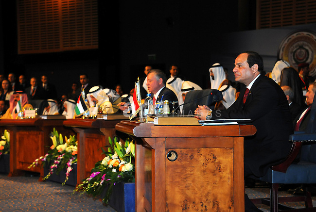"""Egyptian President Abdel Fattah al-Sisi attends the opening meeting of the Arab Summit in Sharm el-Sheikh, in the South Sinai governorate, south of Cairo, March 28, 2015. Sisi told an Arab League summit on Saturday that Cairo backed calls for a unified Arab force to confront regional security threats. Sisi also said Egypt's participation in a military campaign against Shi'ite Houthi militias in Yemen, which has been led by Saudi Arabia, aimed to """"preserve Yemen's unity and the peace of its territories."""". APAIMAGES/Egyptian Presidency"""