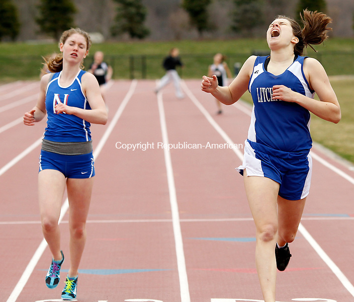 Litchfield, CT- 12, April 2011-041211CM07  Litchfield's Olivia Hayward sprints across the finish line, edging out Nonnewaug's Jackie Nichols during the girls 400 meter Tuesday afternoon in Litchfield. Nonnewaug won the meet, defeating Litchfield and Wamogo. Christopher Massa Republican-American