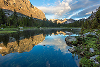 Wind River Range, WY: Horseshoe Lake reflecting clouds and morning light on Mitchell Peak and distant Warrior Peaks from Lizard Head Meadows; Bridger Wilderness in the Bridger National Forest