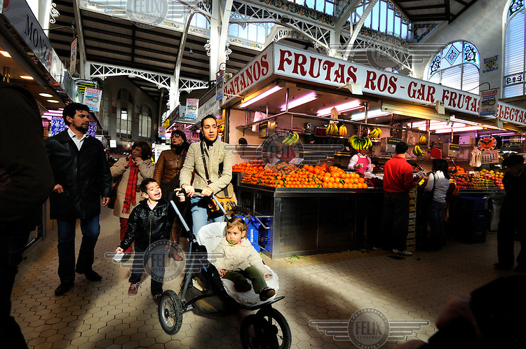 A family walk through Valencia's recently renovated Mercado Central. The market has over 8,000 square metres of space housing over 900 stalls..