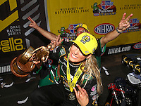 Feb 28, 2016; Chandler, AZ, USA; NHRA top fuel driver Leah Pritchett is photo bombed by crew members as she celebrates after winning the Carquest Nationals at Wild Horse Pass Motorsports Park. Mandatory Credit: Mark J. Rebilas-