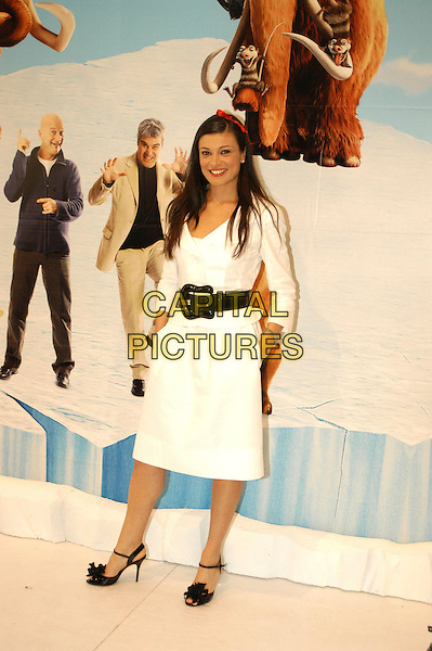 "ROBERTA LANFRANCHI.Photocall for ""Ice Age: The Meltdown"" in Rome, Italy..April 13th, 2006.Ref: CAV.full length white dress black belt.www.capitalpictures.com.sales@capitalpictures.com.© Capital Pictures."