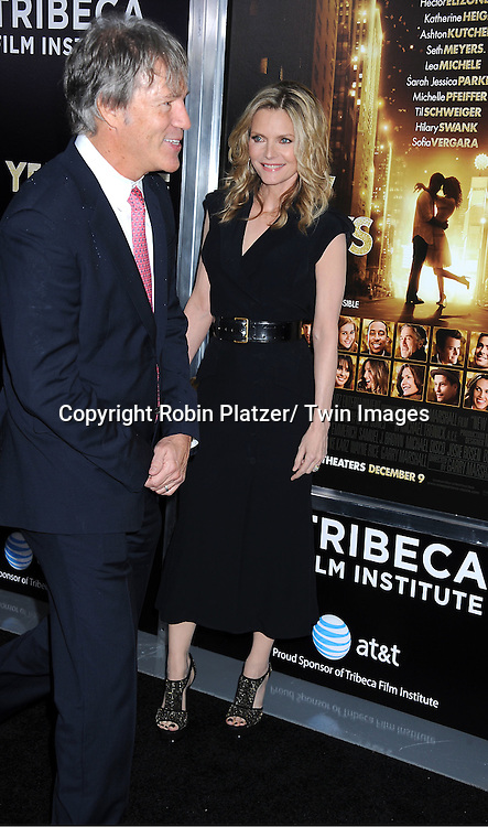 """Michelle Pfeifferand David E Kelly attends The Special Screening of """" New Year's Eve"""" on ..December 7, 2011 at The Ziegfeld Theatre in New York City. The evening is sponsored by AT & T and is benefitting The Tribeca Film Institute ."""
