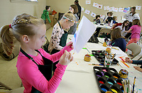 NWA Democrat-Gazette/DAVID GOTTSCHALK  Caroline Gearhart, 7, reviews her Magical Creatures Art Project Wednesday, March 21, 2018, as she participates in Camp Sequoyah - Spring Break 2018 at Mount Sequoyah in Fayetteville. The three day camp offered sessions in Food and Fitness, Art and Drama and Sport and Outdoor.